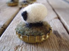 Felted wool sheep in upcycled bottlecaps wholesale by HouseOfMoss, $40.00