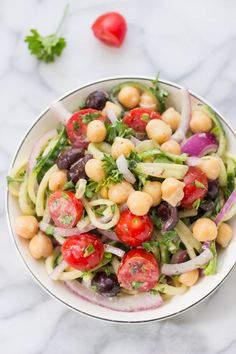 Cucumber Noodle Greek Salad -- a light and refreshing pasta salad that is healthy and satisfying!