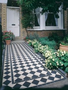Revamping your front garden isnt just about the planting - a posh front path can make a really big impact, too. Tiles by Fired Earth.