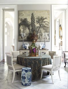 Candlesticks and console, all Rosselli. Grisaille wallpaper panel, tole urn and garden seat, all antiques. Tablecloth in vintage Fortuny fabric.    - Veranda.com