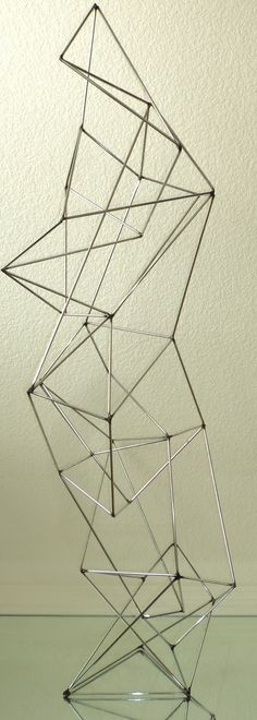 Modern geometric chrome sculpture By artist Corey Ellis