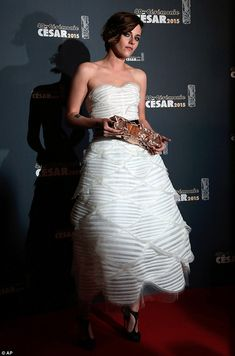 Show stopper! Kristen Stewart stole the show with her stunning strapless gown and took hom...