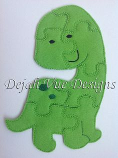 Dinosaur Felt Puzzle and many more items are available for purchase at https://www.etsy.com/shop/SchoolhouseBoutique