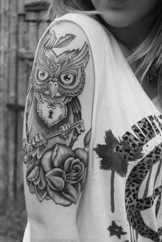 Tribal owl tattoo with key and rose