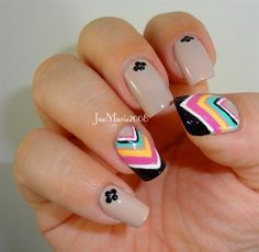 This chevrons nail design is very cute and colorful it has many different sized lines an many different colors... What's great about them it that they will fit on and sized nail so no matter how long or short they are you can do it.!!!!