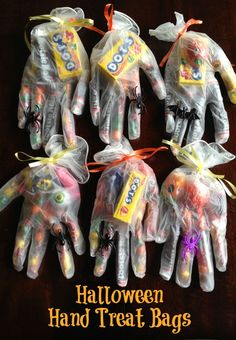 Pin it! My mom loves Halloween. So when she was going to be town the week before Halloween she insisted on bringing supplies for these Halloween Hand Treat Bags. Who am I to pass up someone else paying for Halloween trick-or-treat supplies? I said sure, whatever you'd like. . .. I have to hand it to her. …