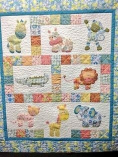 Snuggle Safari by Ladybird Quilts. Kits available @ Jiddi's Patch.  The cutest cot quilt ever.