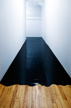 "Highly imaginative use of black paint on  wood floor. ""Redrum""."