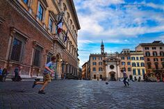 Boys play soccer in a piazza...Rome Italy.