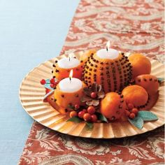 Thanksgiving crafts: Freshen up your tabledecor with this clove citrus candle display, perfect for the fall season.