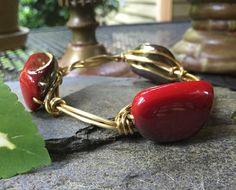 Wire bracelet with shaped deep red stones by HammerandWire on Etsy