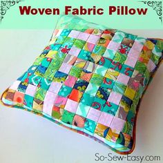 Woven fabric pillow made from weaving strips of folded fabric. Great scrap buster and so pretty too! ~ So Sew Easy