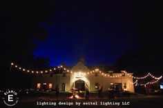 Bistro lights mounted on 12 foot tall iron poles encircle the celebration at the stables building at The Mount. Lighting by Seitel Lighting. Outdoor Tables, Indoor Outdoor, Bistro Lights, Light Table, Table Lighting, Carriage House, Stables, Lighting Design, Amanda