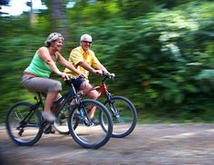 Couple cycling in the forest