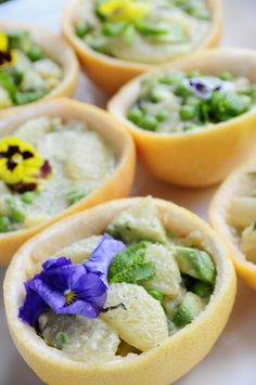 A pea, mint and grapefruit salad, served in hollowed-out grapefruits.  Just the treat for an outdoor party!   By Blue Plate Catering in Chicago