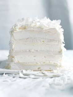 Bake this Coconut Layer Meringue Cake recipe for a lighter-than-air dessert perfect for a bridal shower or birthday party. Köstliche Desserts, Dessert Recipes, Plated Desserts, White Desserts, Dessert Food, Recipes Dinner, Cupcake Recipes, Fall Recipes, Food Cakes