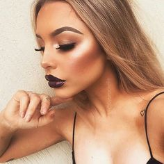 Beautiful highlight and contour with a dark lip.