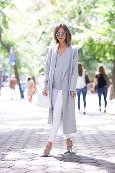 Blogger Style | Arielle Noa Charnas (Something Navy): grey extra-long coat x grey sweater x white skinny jeans x valentino rockstud heels