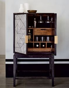 Bar cabinets have popped up in the latest collections from some of our favorite designers, at every price point. Bone inlay makes the graphic black-and-white pattern on this West Elm cabinet pop | archdigest.com