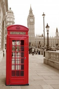 A traditional red phone booth in London with the Big Ben in a sepia background Stock Photo