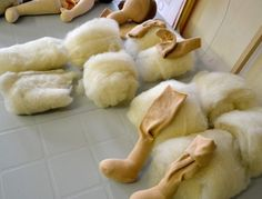 Doll-leg-stuffing - Needlefelt inner core very solidly, then wrap it with a loftier outer layer. If a doll isn't stuffed very solidly, it will easily misshape over time. Also wool naturally felts together through rubbing, so why not start that process before putting lofty fiber into a limb