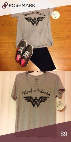 NWT😀Tee shirt NWT Gray comic t shirt. size small 65% polyester 35% rayon. Tops Tees - Short Sleeve