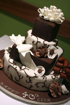 Our Cakes   OC Cake Studio. Love the square on round ckaes and the simple yet elegant design.