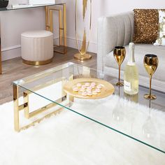 Bring a glamorous touch to your living room with the Plaza Gold metal coffee table. Crafted in a steel frame, it showcases a golden hue and a rectangular design on the table ends with a tempered clear glass table top. Gold Glass Coffee Table, Coffee Table Rug, Gold Table, Coffee Table Design, Glass Table, Center Table Living Room, Table Decor Living Room, My Living Room, Coffee Table Pictures