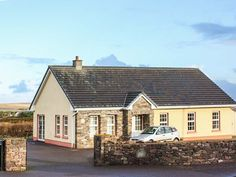 PRICE FROM £376.00 PW SLEEPS 12 BEDROOMS 6 BATHROOMS 3 PET FRIENDLY This traditional, detached cottage near Ballyferriter, Co. Kerry, sleeps up to twelve people (max. 11 adults) in six bedrooms.