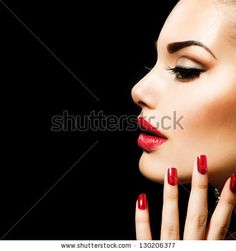 Beauty Woman with Perfect Makeup. Beautiful Professional Holiday Make-up. Red Lips and Nails. Beauty Girl's Face isolated on Black background. Glamorous Woman by Subbotina Anna, via Shutterstock