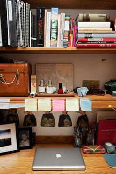Augustus Dayton's frequently featured dorm room deals with a similar problem to mine: a standard issue dorm desk complete with shelving. Looks like her solution was to fill it up with colorful objects and books of different shapes and sizes!
