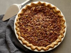 Pecan Pie - This classic pie is especially easy because it does not require blind baking or precooking the filling. The toasty pecans in the sweet, gooey sugar filling taste extra homey when served warm. Enjoy with a dollop of whipped cream!  #Thanksgiving #ThanksgivingFeast #Dessert