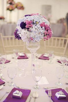 Reception tables were marked with chic rounds of hydrangeas and mums in dreamy hues of blue, purple, and pink. | Decor by K. by Cunanan Catering | www.BridalBook.ph
