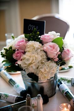 Galvanised bucket centrepiece. Need help with any aspects of wedding planning or styling? Visit www.rosetintmywedding.co.uk