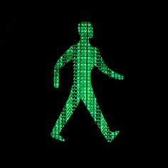 LONDON :: pedestrian sign : green (walking right) by Crystian Cruz, via Flickr