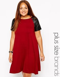 Club L Plus Size Swing Dress With PU Sleeves love this look