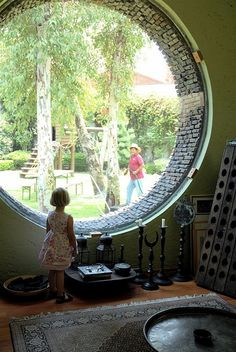 Round windows would make good window seats because you'd have something to lean against....plus, it's just really cool!
