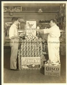 Nathan and his father Joseph stacking iced tea inside the family's Shankman's Market
