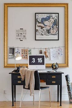 Cordon off your workspace with an empty custom frame - use this large amount of wall space to hang calendars, to-do lists, inspirational images, etc. It's beautiful and functional! | Larson-Juhl Custom Frames