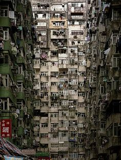 Kowloon Walled City was a densely populated, largely ungoverned settlement in Kowloon, Hong Kong. Originally a Chinese military fort, the Walled City became an enclave after the New Territories were leased to Britain in 1898. Its population increased dramatically following the Japanese occupation of Hong Kong during World War II. In 1987, the Walled City contained 33,000 residents within its 6.5-acre (0.026 km2; 0.0102 sq mi) borders.