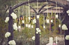During the ceremony add votive candles to the jars and hang them from trees, cluster them together for a backdrop or hang them from ceremony chairs to use as pew ends. www.glendaloughmanor.com/log