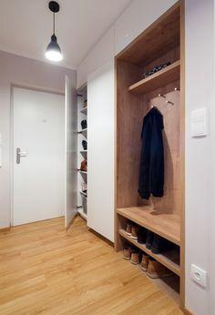 Concealed behind sliding door in hall so that it is hidden when the door is open and visible when shut.