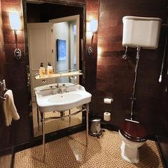 Washstand in Front of Floor Mirror