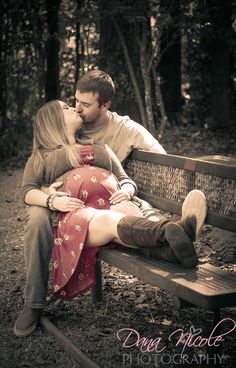 Maternity photo on bench. Too bad I hate how I look when we kiss...but otherwise sweet