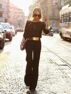 chic black jumpsuit with a sleek gold metal belt