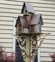 wrought iron brackets dress up & stabilize the bird houses on the post.  --  Cherry's ... In the garden