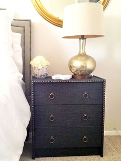 Upholstered Upholster a plain cheap chest with a heavy-duty linen fabric. Add nail heads and gold ring pulls to complete the look.