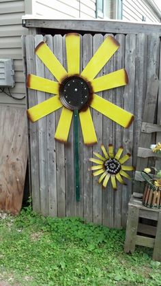 My sunflower I made using old ceiling fan blades and a old pan I found.  I love sunflowers!!!