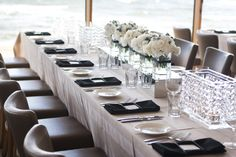 Table linen & centrepiece by Table Art. Latte Stripe overlay with black napkins, mirror box table runner & crystal table chandelier. Floral by Leigh Clark.  Photography by Alexander McIntyre.  www.tableart.com.au