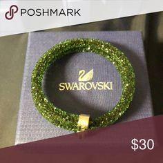 Swarovski Crystaldust double wrap in emerald Brand new never worn. Don't have the price sticker for it. Swarovski Jewelry Bracelets